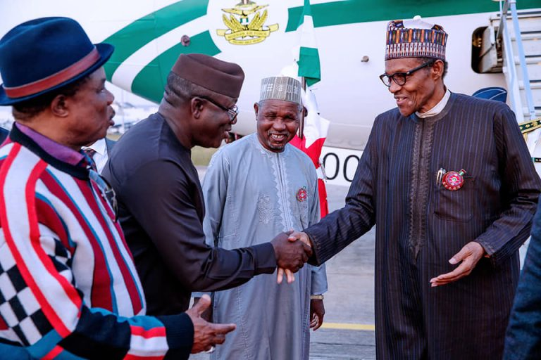 Buhari-returns-from-Paris1-768x512